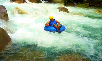 Water Tubing, Zip Lining, Dino Park or Blue Volcanic River Tours
